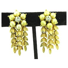 Signed Sarah Cov gold tone clip-on dangling Earrings with imitation pearls and crystal rhinestones