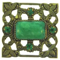 Vintage early square Brooch with green rhinestones and celluloid center
