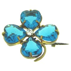 Vintage early flower or clover Scatter pin with blue glass stones and crystal rhinestone
