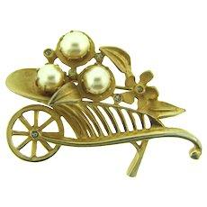 Vintage figural gold tone wheel barrow Brooch with imitation pearls and crystal rhinestones