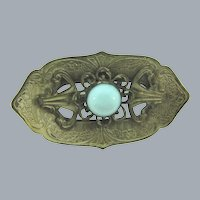 Vintage early silver tone Sash Pin with light blue glass cabochon