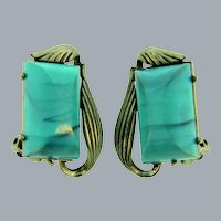 Signed Coro vintage clip-on Earrings with mottled blue thermoset cabochons