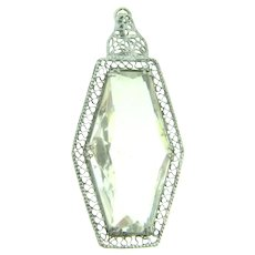 Vintage long Pendant with clear glass stone in a filigree silver tone frame