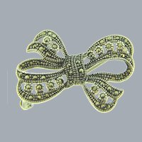 Stamped 925 sterling silver bow Brooch with marcasites