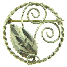 Marked Sterling silver circular leaf and vines Brooch