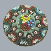 Vintage circular mosaic Brooch with a center floral design