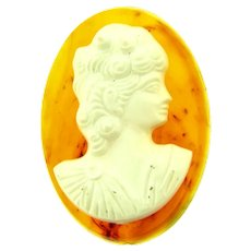 Vintage white plastic Cameo on Lucite base