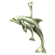 Marked Sterling silver figural dolphin Pendant