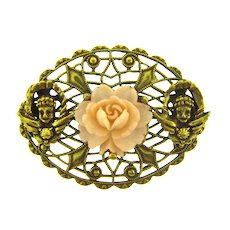 Vintage gold tone Brooch with pink plastic flower and angels