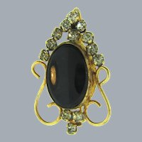 Vintage curling Brooch with crystal rhinestones and black glass cabochon