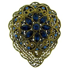 Vintage gold tone Dress Clip with blue rhinestones