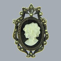 Vintage Mother of Pearl cameo in silver tone frame with marcasites