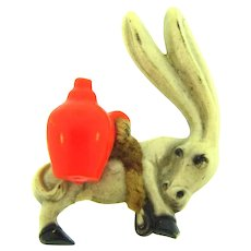 Cute figural early plastic donkey with jug Brooch