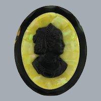 Vintage early black basalt Cameo Brooch on glass background