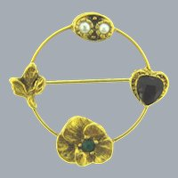 Vintage circular gold tone charm Brooch