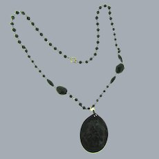 Vintage black beaded Necklace with large black celluloid cameo pendant