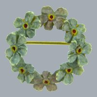 Small carved celluloid tinted floral early Scatter Pin