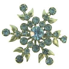 Vintage retro silver tone floral Brooch with blue rhinestones