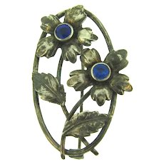 Marked sterling silver vintage floral Brooch with blue rhinestones