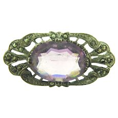 Marked Sterling silver smaller Brooch with purple glass stone and marcasites