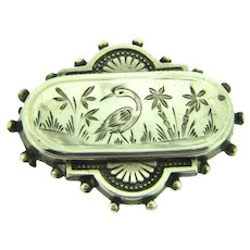 Vintage early sterling silver Brooch with bird and flower chased design