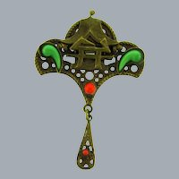 Vintage Oriental pagoda design Brooch with green and red cabochons