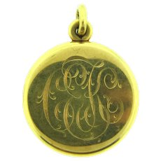 Vintage gold filled Locket with initials CEK and old pictures