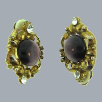 Vintage gold tone clip-on Earrings with purple cabochon and crystal rhinestones