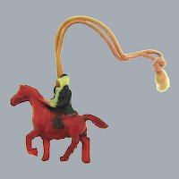Vintage celluloid tinted horse and rider Charm
