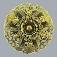 Vintage gold tone floral Brooch with a lacy base