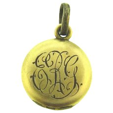 Tiny gold filled Locket with initials ERG in script