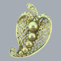 Signed Coro gold tone leaf Brooch with imitation pearls and crystal rhinestones