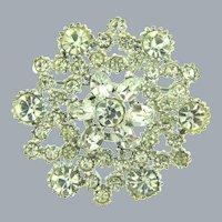 Small vintage snowflake brooch with crystal rhinestones