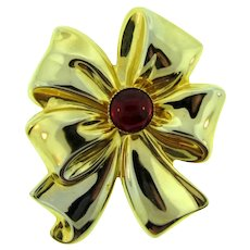 Vintage large gold tone bow Brooch with red plastic cabochon