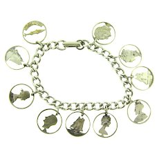 Vintage silver tone charm Bracelet with cut out coin Charms