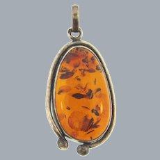 Vintage large amber cabochon set in marked 925 silver frame Pendant