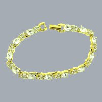Signed Monet gold tone tennis Bracelet with crystal rhinestones