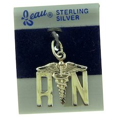Signed Beau Sterling Silver RN Charm