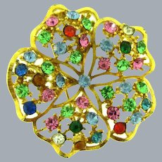 Signed Lisner flower Brooch with colorful rhinestones