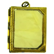 Vintage gold tone book Locket with thermoset cover