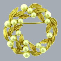 Signed Crown Trifari circular Brooch with faux pearls