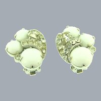 Signed Eisenberg clip-on Earrings with white cabochons and crystal rhinestones