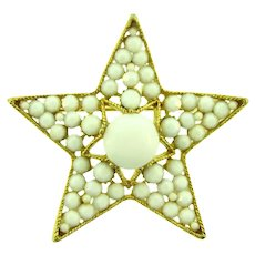 Signed BSK large figural star Brooch with white cabochon and rhinestones