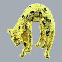 Vintage figural leopard Brooch/ Pendant with black enamel spots and red rhinestone eye
