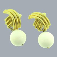 Signed N.J. clip-on gold tone Earrings with dangling large white plastic beads