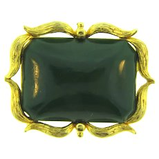 Signed West gold tone Brooch with green plastic cabochon
