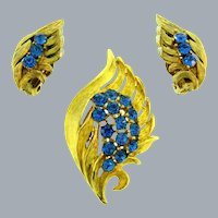 Vintage gold tone Brooch with blue rhinestones and matching clip-on Earrings