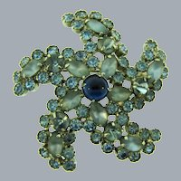 Signed Weiss large pinwheel rhinestone Brooch in blue shades