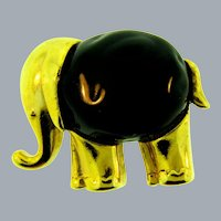 Signed KJL gold tone figural Elephant Brooch with black plastic cabochon