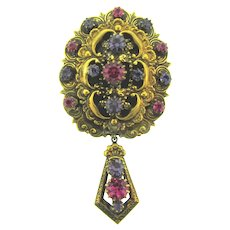 Signed St. Labre gold tone Brooch with dangle and pink and purple rhinestones